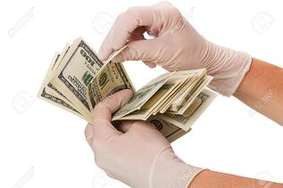 surgical gloves and cash
